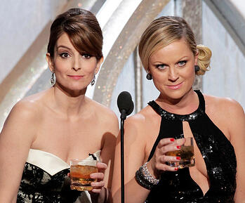 Tina Fey and Amy Poehler host the Golden Globes in 2013; photo by Paul Drinkwater