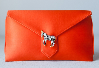 Red purse with zebra accent