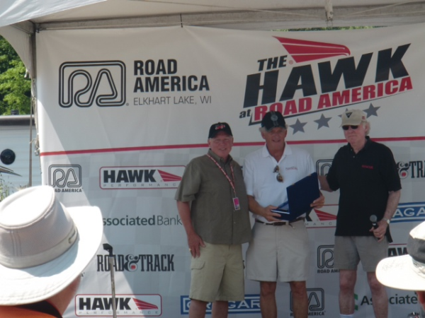 Bob Bailey (center) is awarded the Road & Track Magazine Award for The Car We'd Like to Race
