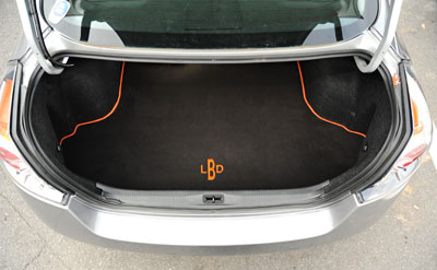 Monogrammed, custom-fit trunk mat by GG Bailey
