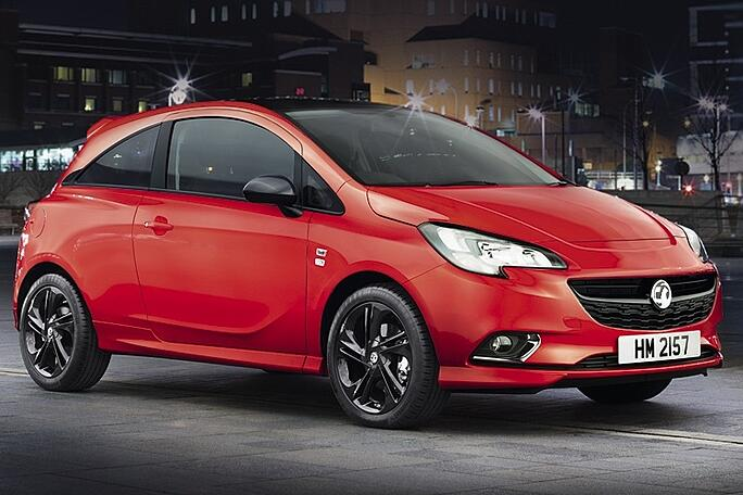 Red Vauxhall Corsa hatchback car